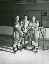 At left, George was a two-time NCAA Champion at DU from in 1960 and 1961